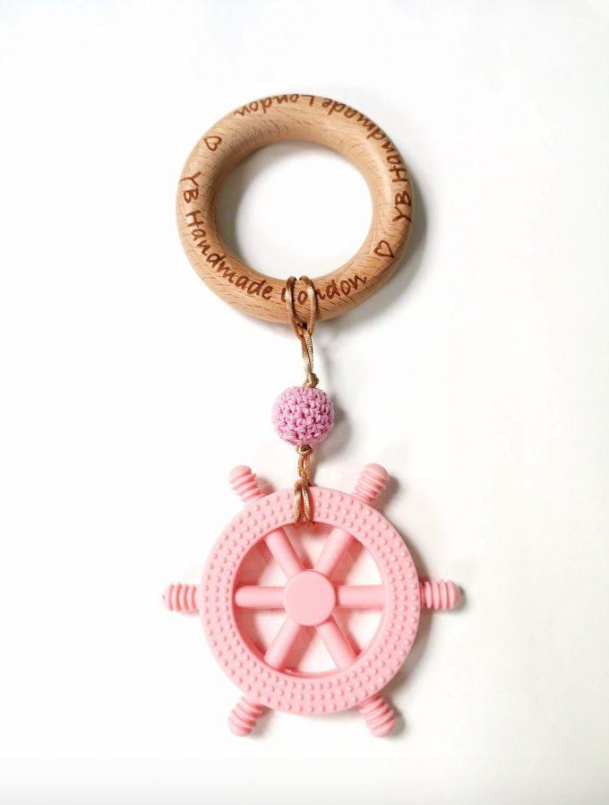 little captain teething bracelet - baby pink